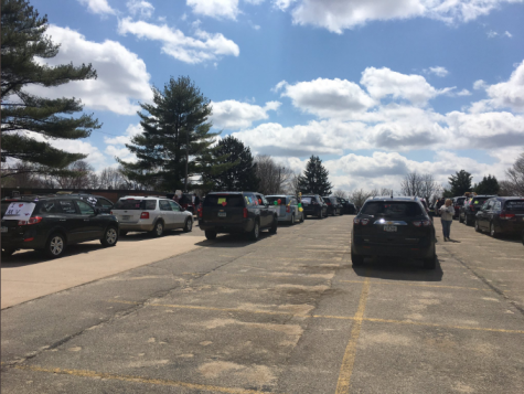 Mount Vernon Community School District Staff line up their cars, getting ready to parade through town Apr. 15. Photo from twitter.