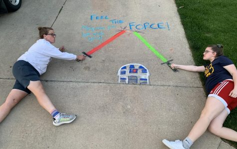 Crystal Eskelsen and daugther Macy, a freshman, pose with their chalk art. The Eskelsens started the Facebook group Fresh Air Heads to inspire the community to get outside safely during social distancing.