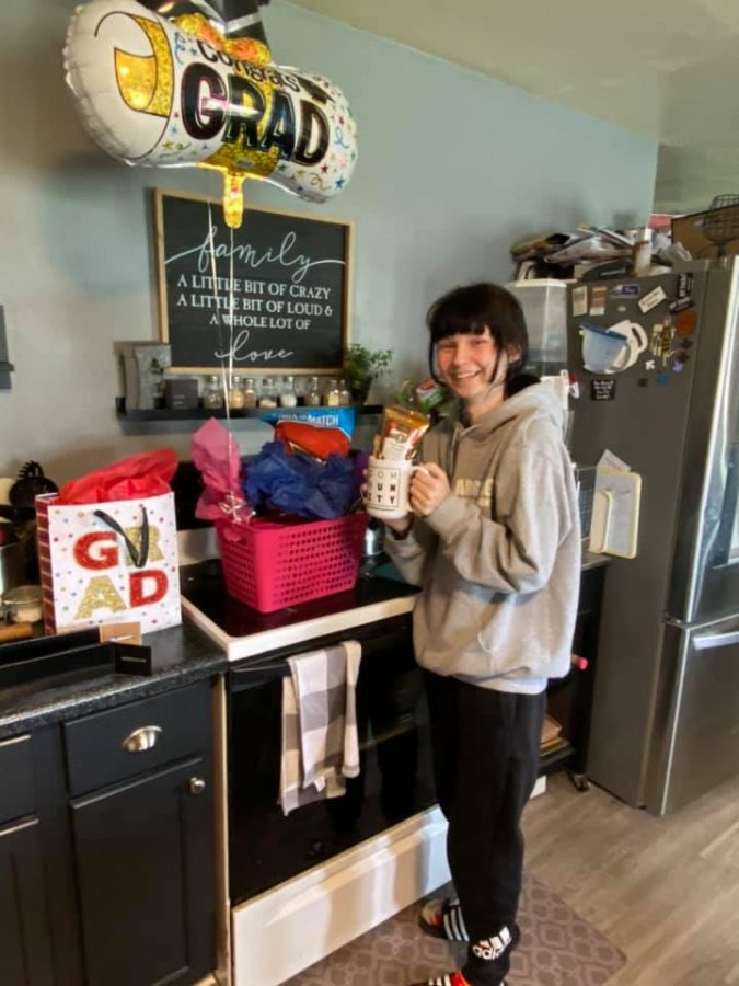 Lexi Flockhart poses with her gifts from the Hanson family May 13.