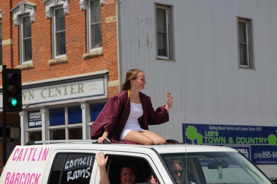 Caitlin Babcock rides in the parade May 24.