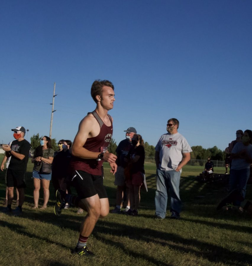 MOVING FOR THE MILE Senior Ashton Hunt picks up the pace as he has one mile to go.