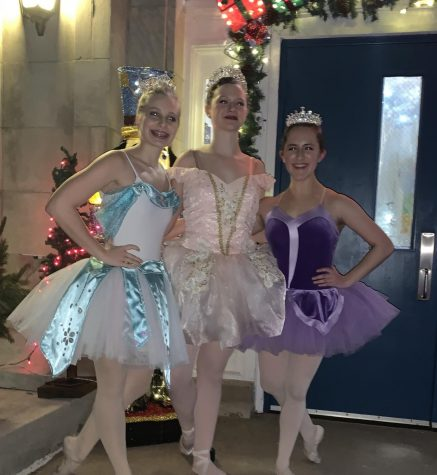 Ashlee Elliott stands with her two friends, Angel Barkalow and Emrys Yamanishi, after their 2019 performance of the Nutcracker.