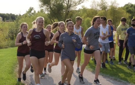 PRE MEET WARM UP Varsity girls jog around the course before they place 4th at the Solon XC meet on Sept. 21.