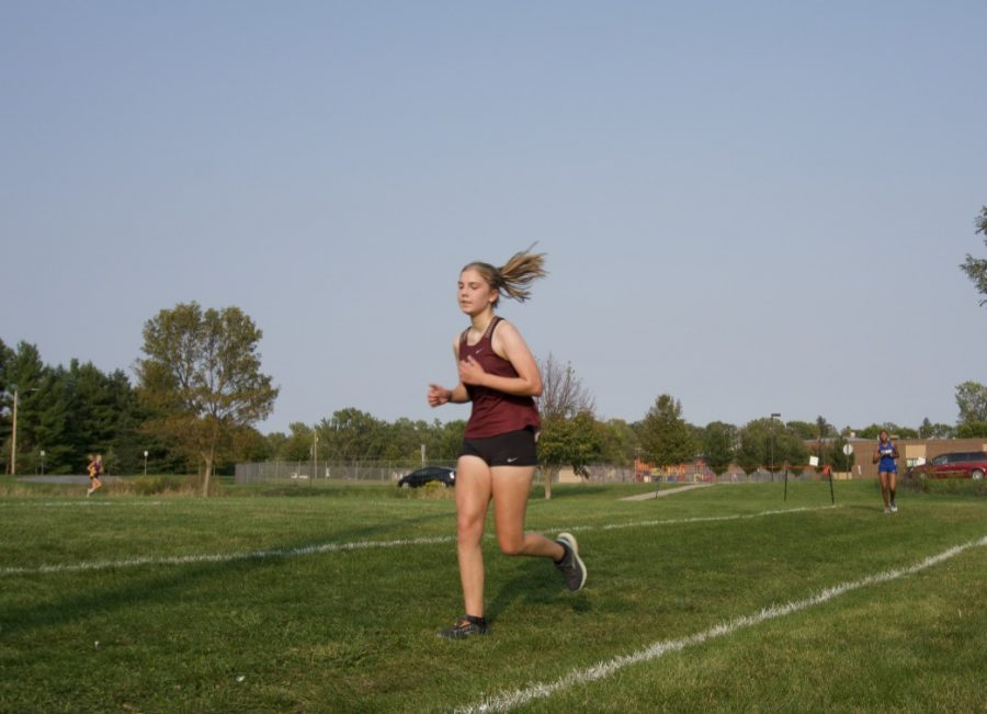 LAST LAP Freshman Anna Vavricek concludes the MVL Varsity girls race with a time of 24:56.
