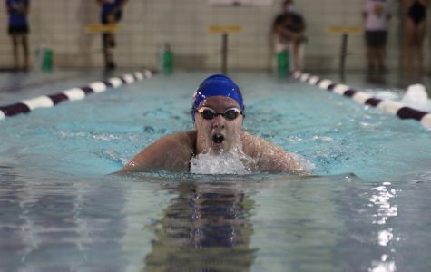 While swimming the 100 breaststroke, freshman Cora Wheeler comes up for a breath Sept. 3. Photo by Lillie Hawker.