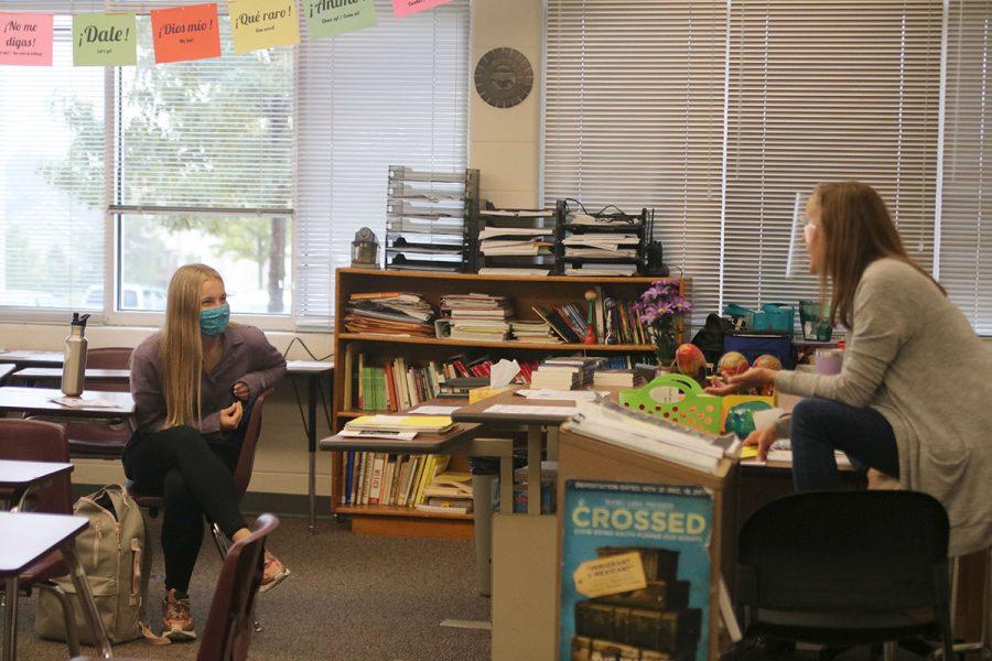 In Spanish 3 Señora Nichols talks to her student Ashlee Elliott.