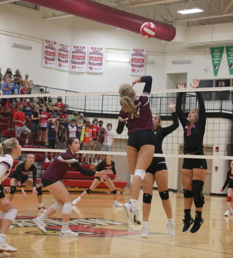 Danielle Pitts a senior hits right side in the varsity match against Maquoketa. The Tuesday night match is won by the Mount Vernon Mustangs from 3-0.