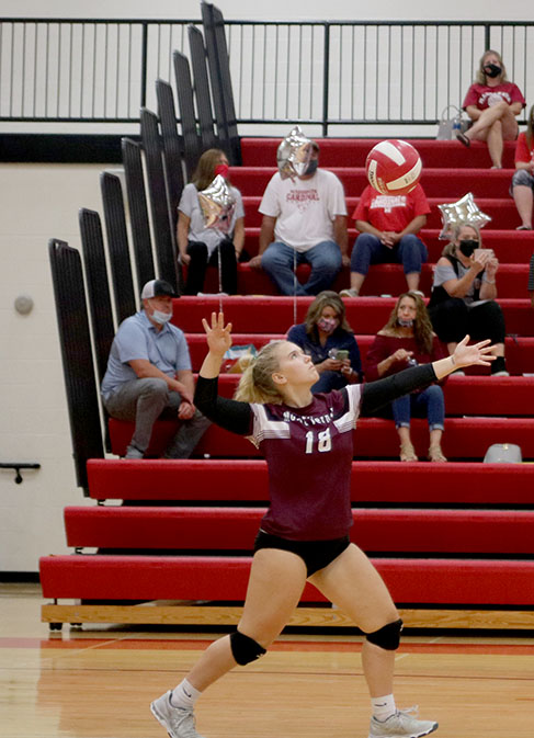 Senior Kiki Blythe serves against Maquoketa during Tuesday nights match. The Mustangs win this match and continue to stay undefeated.