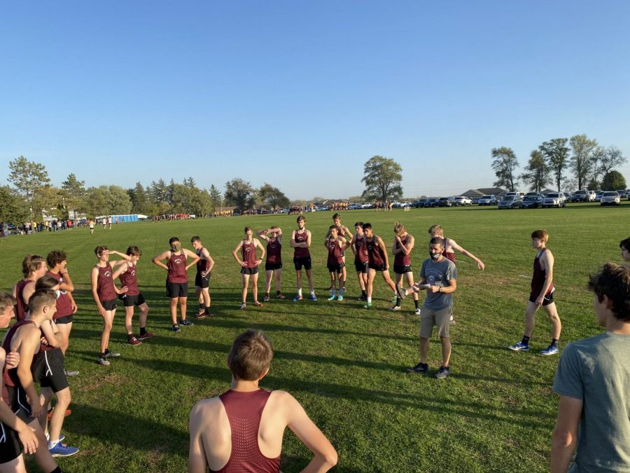 Coach Kory Swart pumps up the boys team before the race Oct. 6.