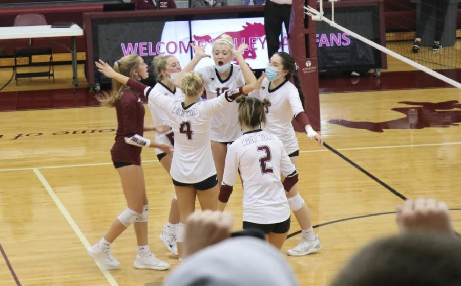 The Mustangs celebrate a point in the third winning set against Williamsburg Oct. 21.