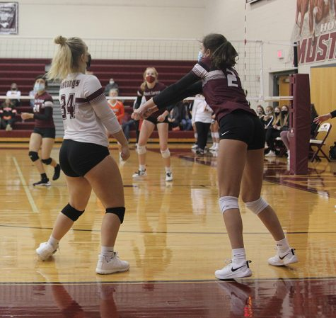 Piper Price bumps a ball to her setter in Monday night