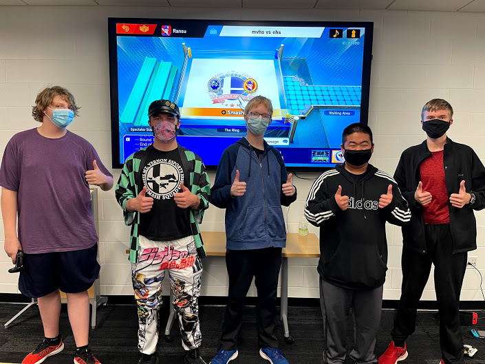 Esports players Logan Eriksen, Jasper Rood, Lance Eriksen, Eli Krob and pose for a photo at their competition Nov. 19.