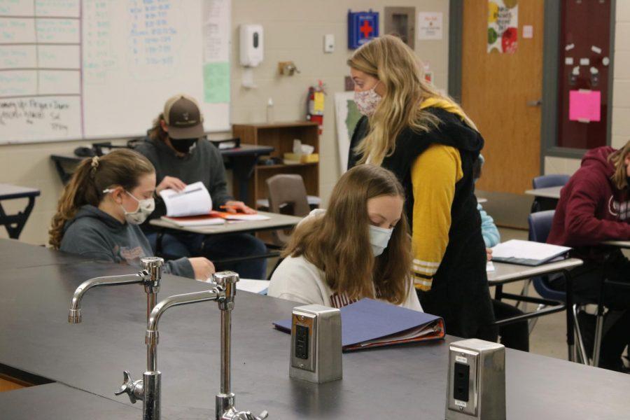 Science teacher Michaela Just works with Chem 1 students Nov. 13.