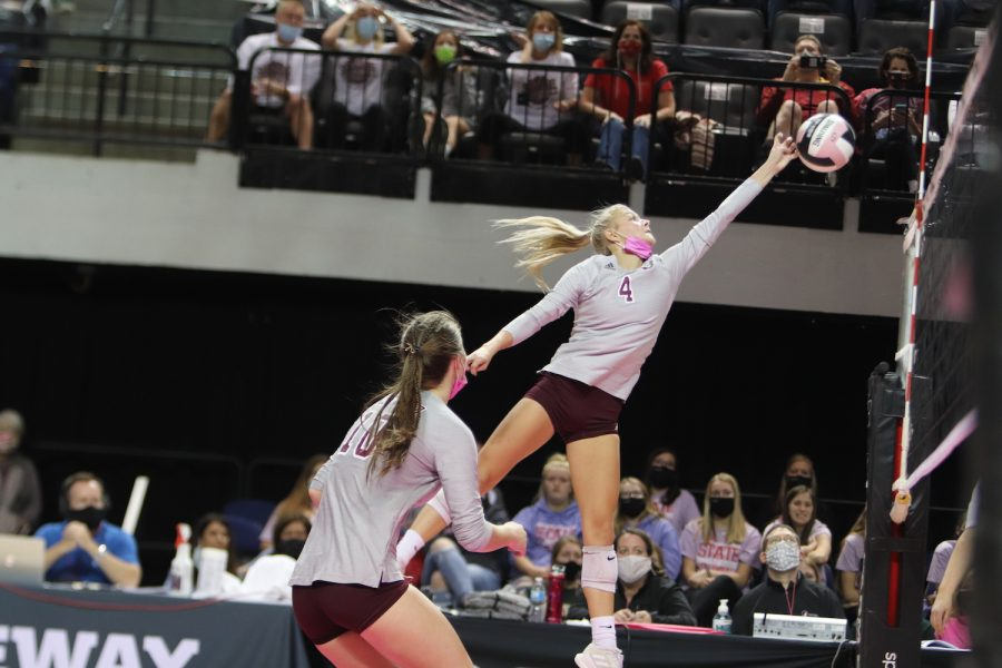 Sydney Dennis, a senior, jumps high to spike the ball over the net at the championship game Nov. 5. Mount Vernon ended the season as State Runner-ups.