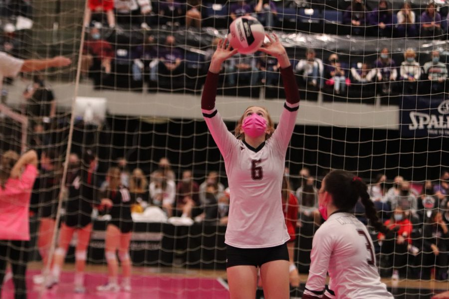 Sophomore Madeleine Miller sets the ball for her teammate to spike it at the semifinal game Nov. 4. Miller had seven assists in the game.