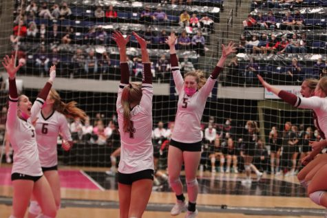 The Mount Vernon Volleyball team celebrates after getting the match winning point in the State Semifinal game Nov. 4. Mount Vernon went on to play in the State Championship game the next day.