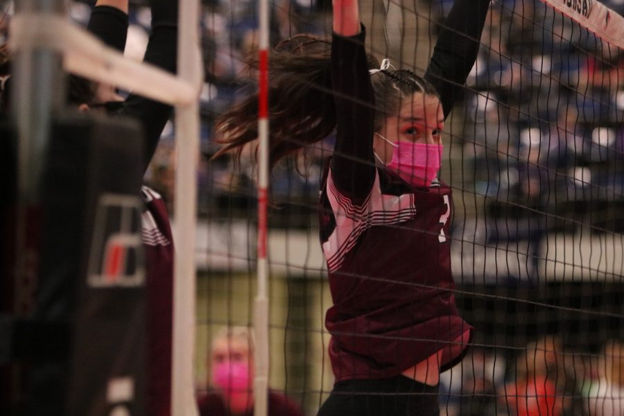 Keeping an eye on the ball, junior Sara Rhomberg jumps up to block the ball at the State Quarterfinal game Nov. 3. Mount Vernon beat Union 3-1.