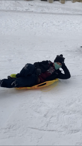 Junior Mark Liberko sleds in style.