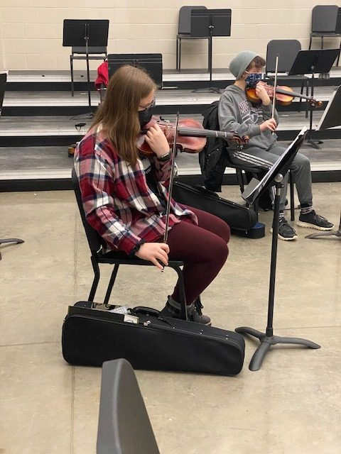 Junior Abbey Keen tunes her instrument before her first hour orchestra class on Jan. 7.