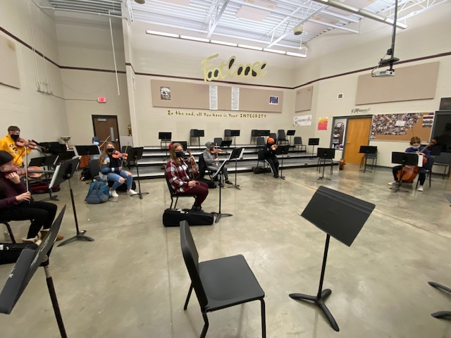 The Mount Vernon High School orchestra gets their instruments ready to play on Jan. 7.
