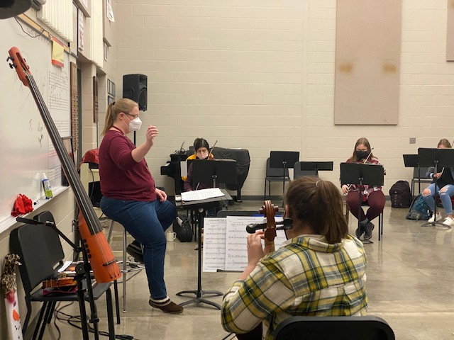 Orchestra teacher Tabitha Rasmussen conducts the orchestra on Jan. 7.