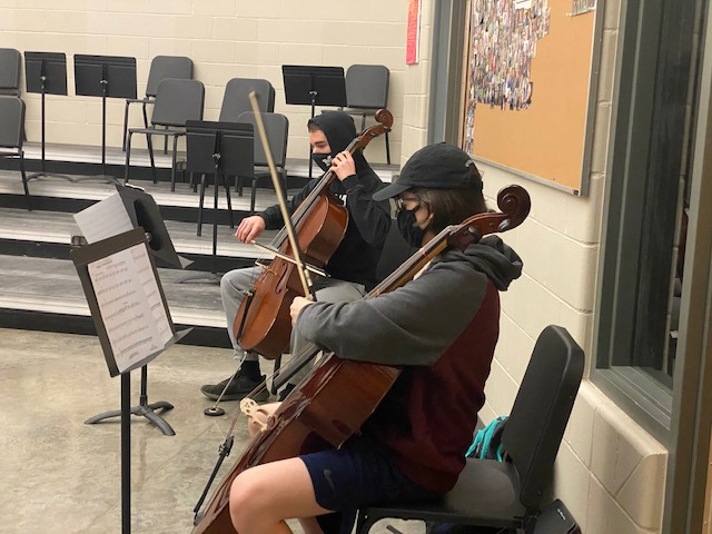 Freshman Ranger Hanna and Sophomore Lawson Hasley practice the cello for orchestra on Jan. 7.