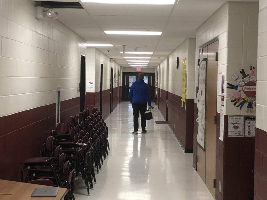 December 23, 2020 began with a walk through the long, empty halls of Mount Vernon's elementary school. The main mission of the day was for the district's tech team to check every room's wired connection to the school's network. At Vance Arnold's side, swinging loosely as he walked, hung the network tester, an IT worker's tool of choice.