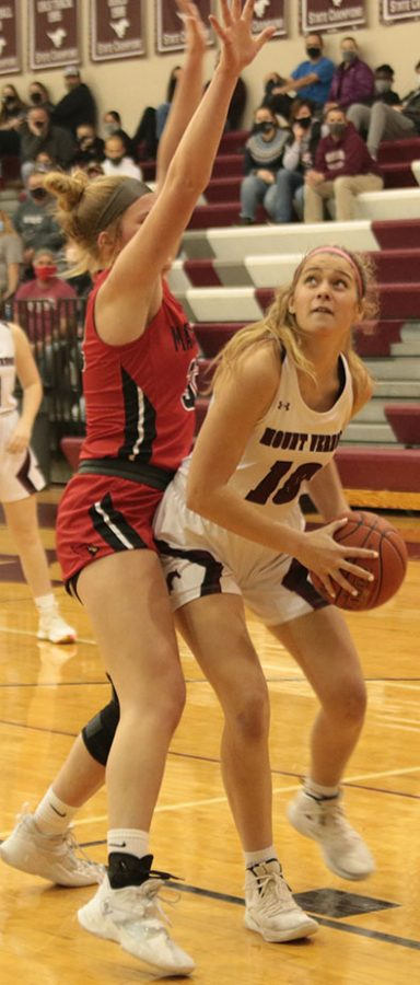 Senior Natalie Welch posts up against Maquoketa to score 2 of her 11 total points.