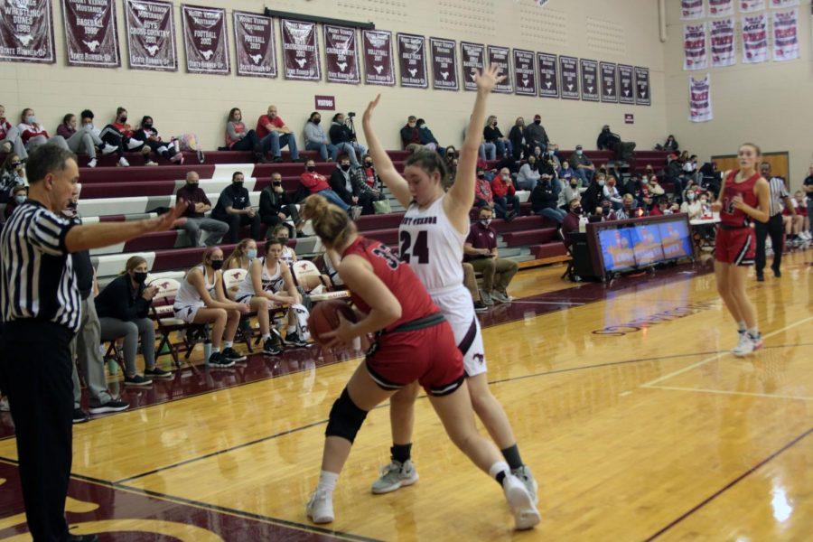 Senior Bethany Richardson pressures the basketball against Maquoketa's point guard.