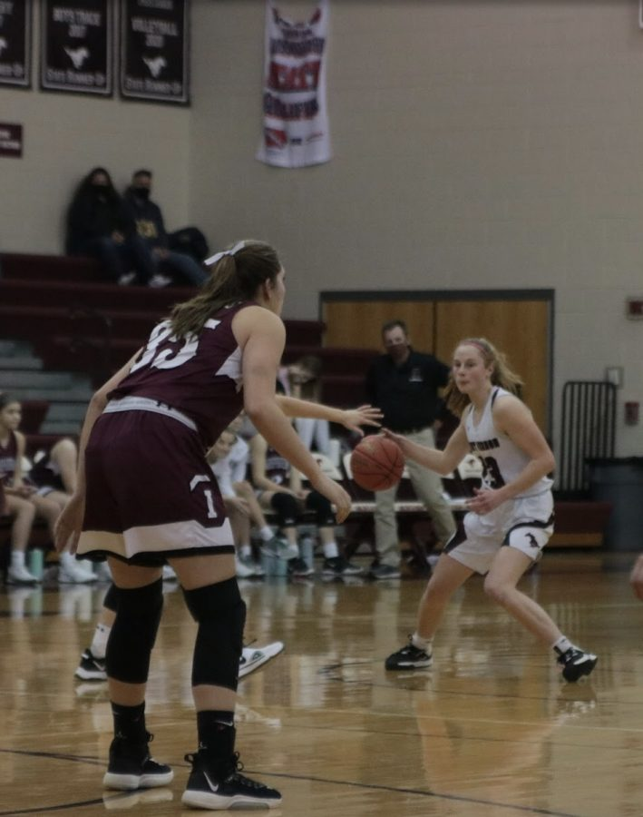 Lily See plays in a varsity match against the Independence Mustangs Jan. 19.
