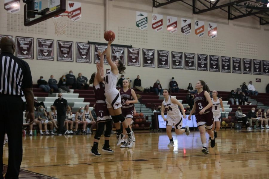 Junior Elizabeth Dougherty goes up to shoot a basket against Independence Jan. 19.
