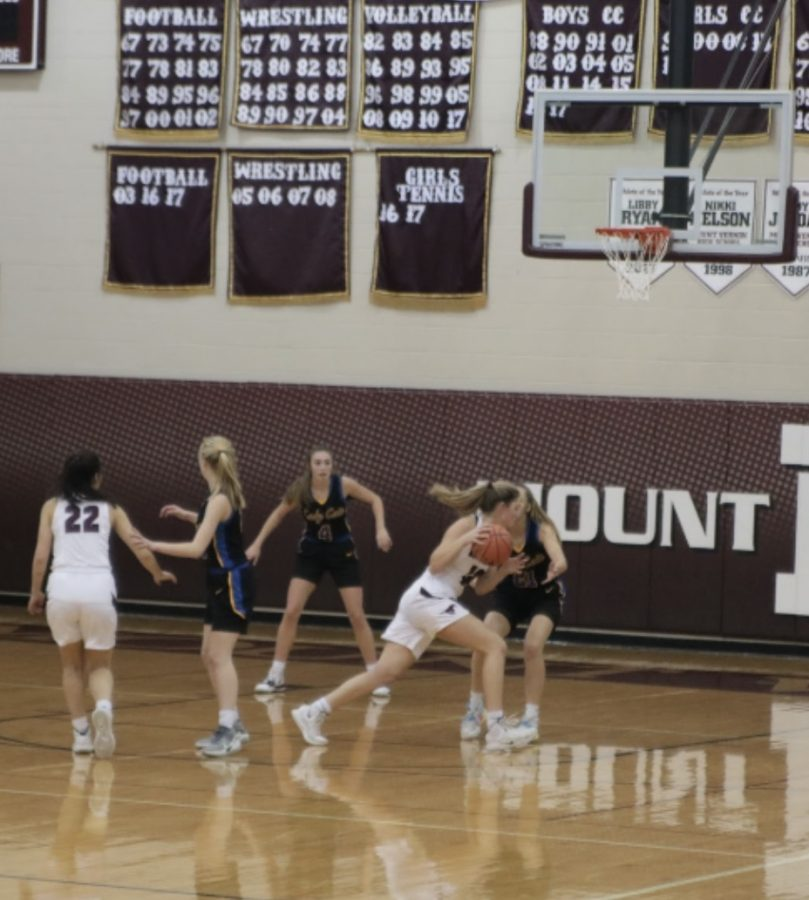 Senior Natalie Welch goes in to score a point for the Mustangs against Benton Dec. 10. Benton won 55-27.