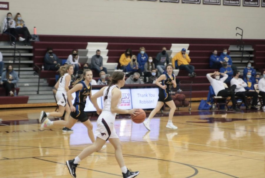Nadia Telecky, a junior, plays in the match against the Benton Bobcats Dec. 10.
