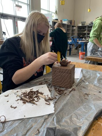 Freshmen Gabby Rubner adds the final details to her clay box Feb. 3.