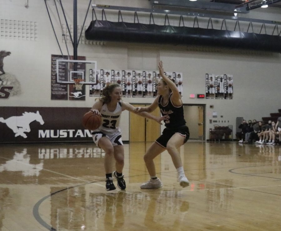 Lily See a current sophomore plays on offense against the Western Dubuque Bobcats Feb. 2. The Mustangs lost 37-29