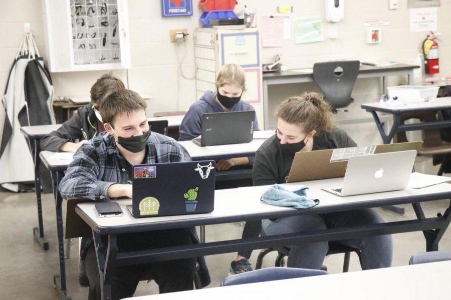 Seniors Benjamin Moss and Ellen Crock take a chem lab test during the Slinger Satellite Invitational Jan. 30.