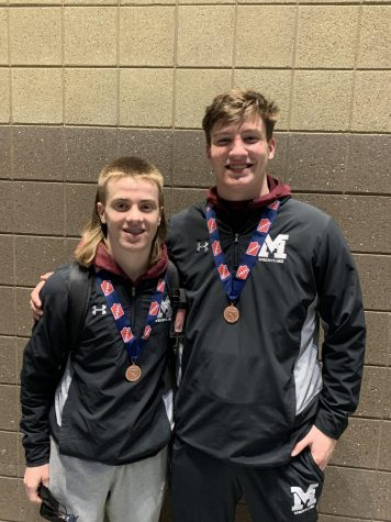 Freshman Jackson Jaspers and Senior Keean Kamerling pose with their state medals.