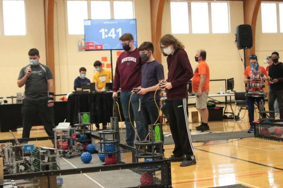 Kian Hageman and Kai Yamanishi of team 85C are paired up with Mitchell Gage of team 85A in qualification rounds at state robotics March 27.