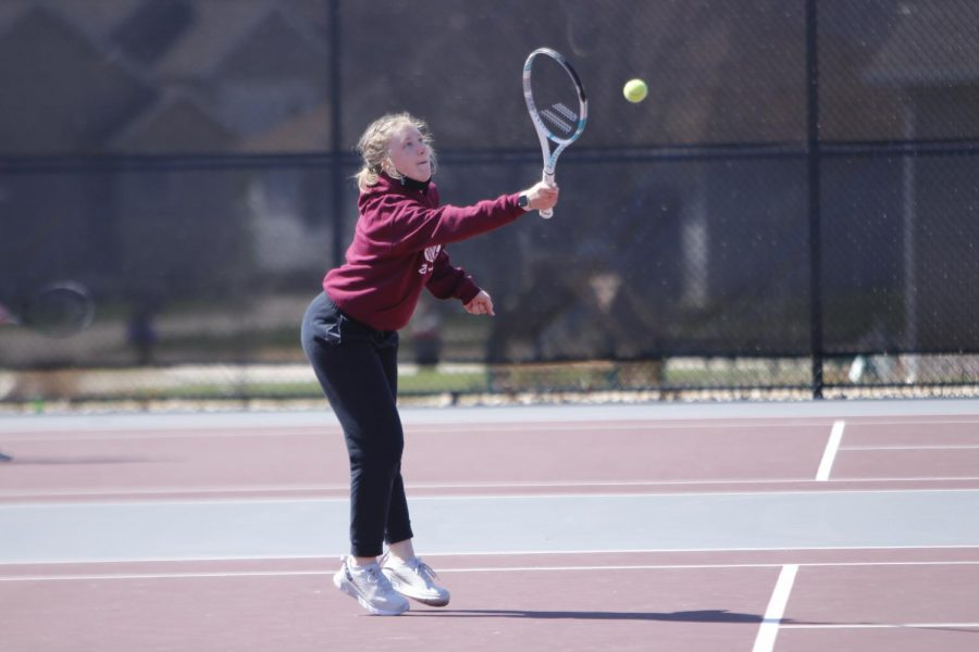 Junior Kasia Wiebel returns the ball to her opponent.