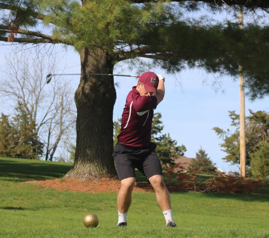 Senior Collin Swantz back-swings with his driver.