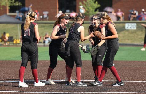 Players celebrate on the mound between plays July 6. The Mustangs won the Regional Quarterfinal game 8-0 against Center Point Urbana  on the new home field.
