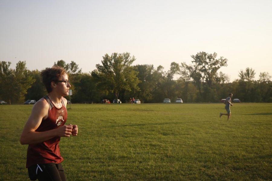 Junior Ben Merlak runs at the Cedar Rapids Invitational on Sept. 9.