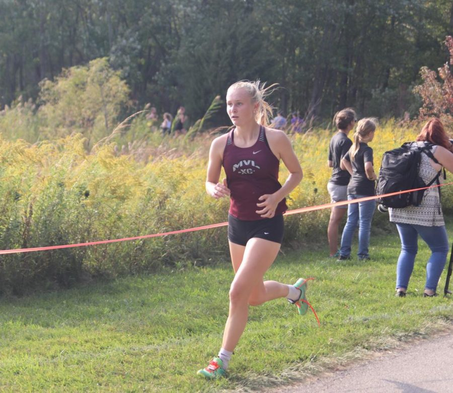 Senior Anna Hoffman keeps a strong pace on the Solon Nature Center trail Sept. 20.