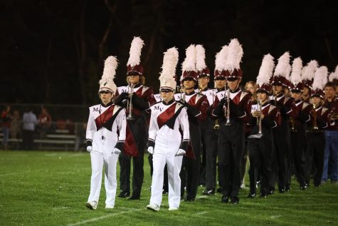 The Marching Mustangs take the field.