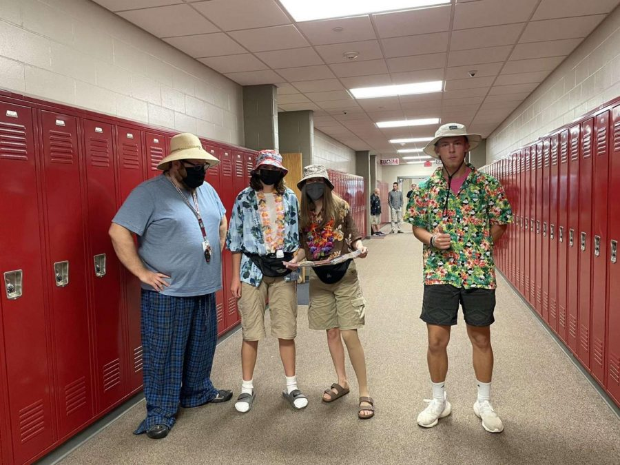 A group of students and a teacher ready for tacky tourist Tuesday.