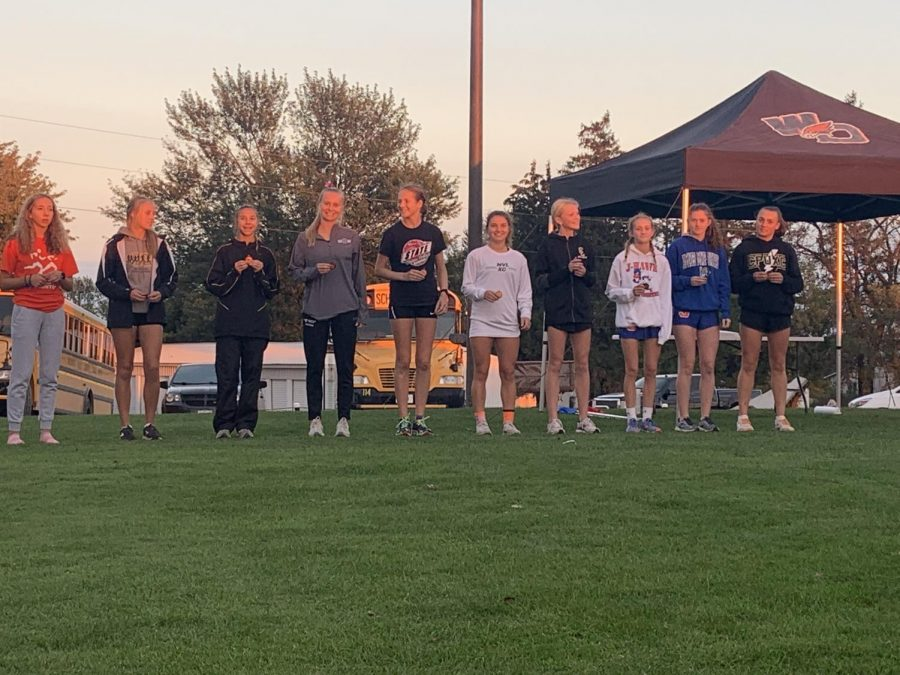 Junior Laura Swart takes fifth and senior Anna Hoffman takes seventh in the cross country meet Oct. 5 in the West Delaware Invitational at Hunt Ridge Golf Course in Manchester. The girls placed second out of 25 teams.