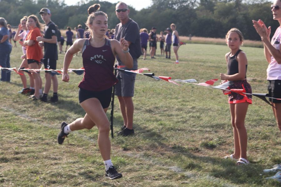 Junior Laura Swart crosses the finish line in 19:48 at the Solon Invitational Sept. 20.